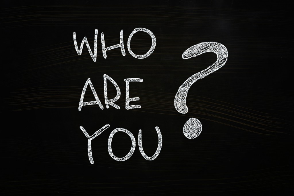 Who are You Lettering written with Chalk on Blackboard